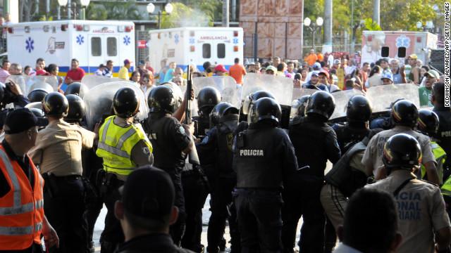 Venezuela's National Guard take shelter during a riot outside Uribana Prison in Barquisimeto, Venezuela.