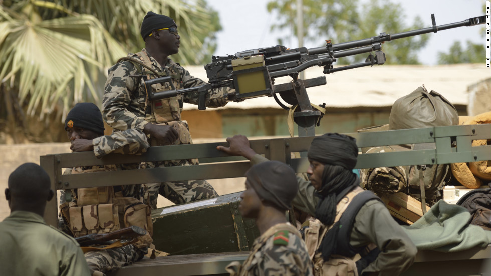 Malian soldiers patrol a street of Diabaly on January 26.