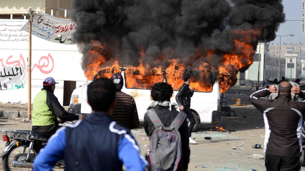 Smoke billows from a burning vehicle set on fire by Egyptian protesters outside the Port Said prison on January 26.