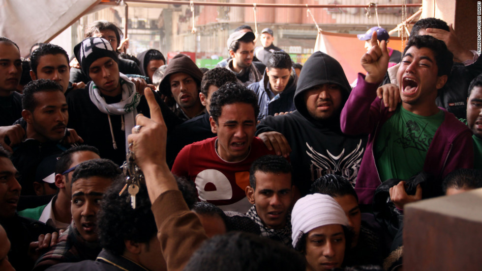 Egyptians react after the sentencing in Port Said on January 26.