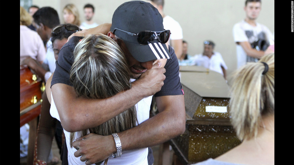 People console each other during a collective wake for the victims of the nightclub fire.