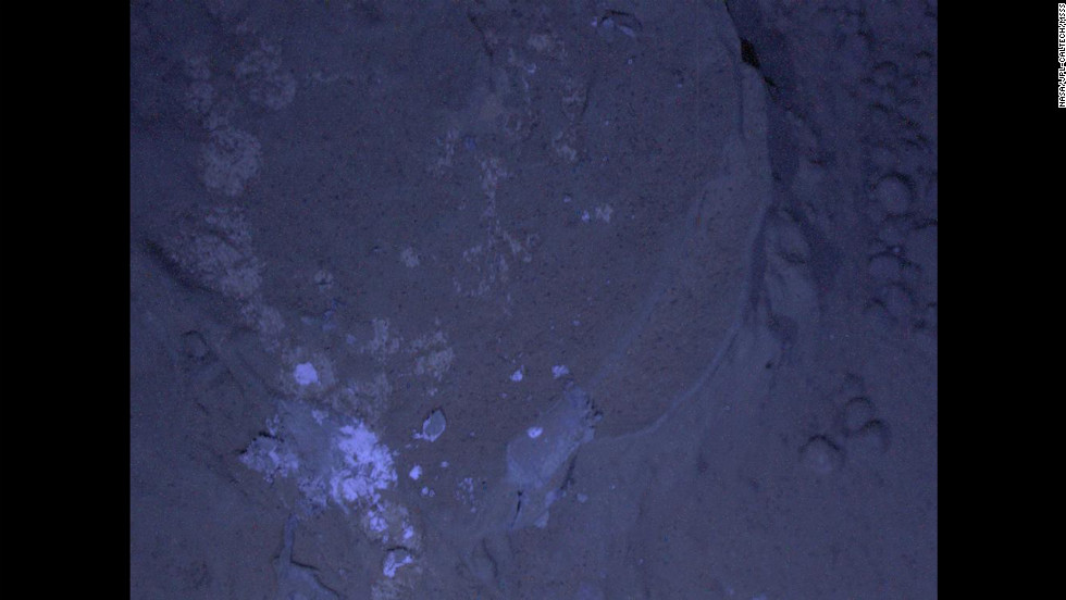 Curiosity's first set of nighttime photos include this image of Martian rock illuminated by ultraviolet lights. Curiosity used the camera on its robotic arm, the Mars Hand Lens Imager, to capture the images on January 22, 2013.
