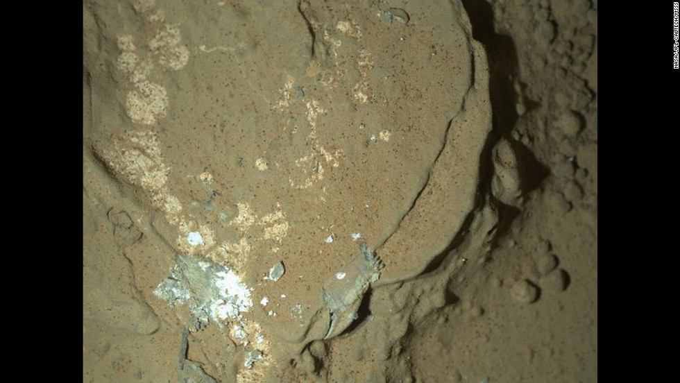 Another nighttime image includes this rock called Sayunei in the Yellowknife Bay area of Mars' Gale Crater. Curiosity's front-left wheel had scraped the rock to inspect for fresh, dust-free materials in an area where drilling for rock would soon begin.