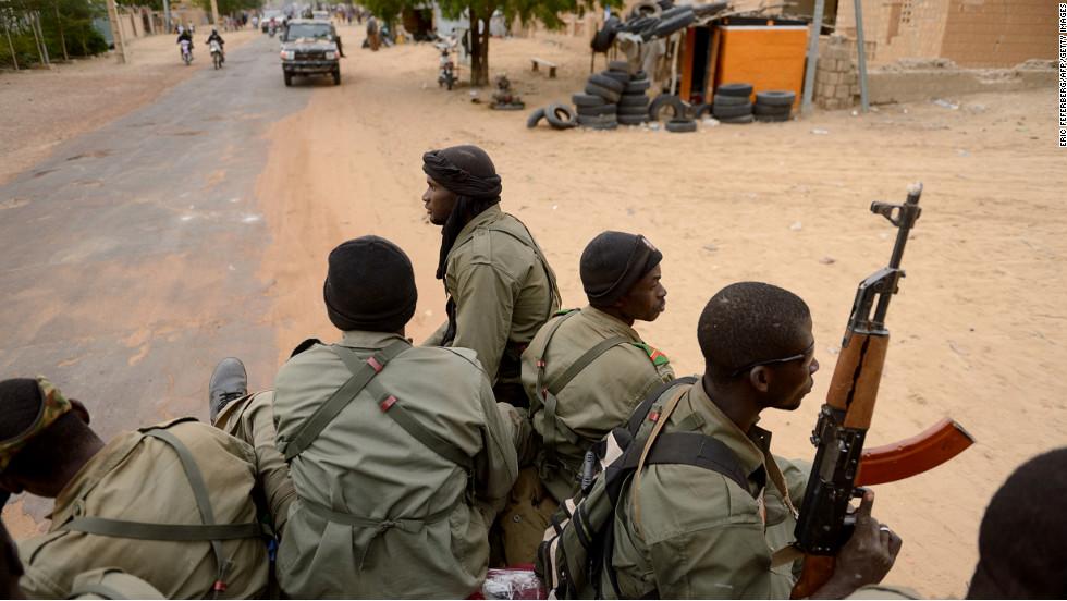 Malian soldiers enter the historic city of Timbuktu on Monday, January 28.