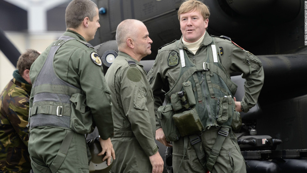 Willem-Alexander (right) talks to soldiers during a visit to Gilze Rijen airbase on November 13, 2012.