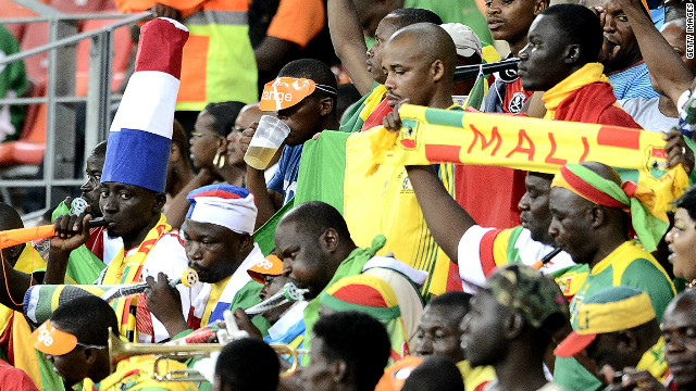 Mali football fans, some significantly sporting hats in French colors,  follow their team at the Nations Cup in South Africa.