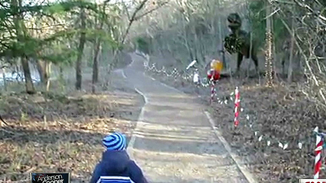 Dinosaur roars; kid runs