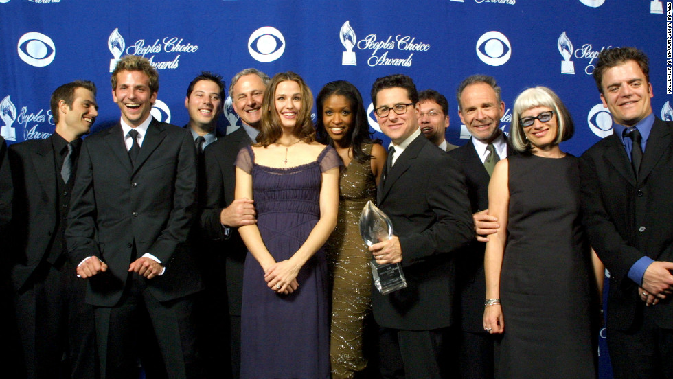 "Jennifer Garner became a household name in 2001 with ABC's ""Alias,"" a show Abrams came up with after imagining what Felicity might be like as a CIA spy. Here the cast and crew, including a young Bradley Cooper, celebrated their People's Choice Award in 2002."