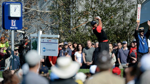 U.S. golf star Tiger Woods hits off the 10th tee during the final round at the Farmers Insurance Open on Monday.