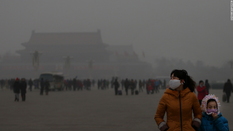 A tourist and her daughter visit Tiananmen Square during dangerous levels of air pollution on January 23.
