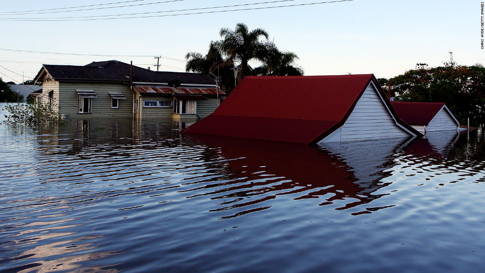 Water engulfs houses in Bundaberg on January 29. The town's hospital has been evacuated as floodwaters advance.