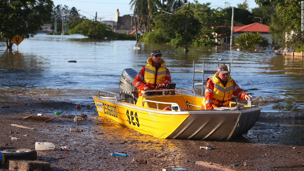 Emergency workers patrol flooded streets by boat in Bundaberg on January 29. The coastal town northwest of Brisbane has been particularly hard hit.