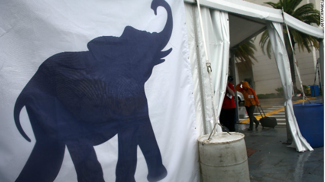 An elephant signs stands in the wind and rain at the Republican National Convention last August in Tampa.