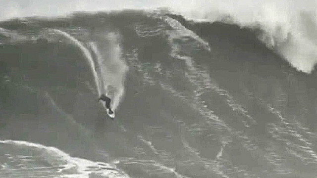 See surfer conquer epic wave