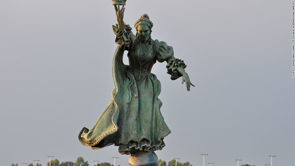Raymond Kaskey's sculpture of Queen Charlotte of Mecklenburg, for whom the city of Charlotte is named, oversees the city's airport. Charlotte came in second for ease in connecting flights.