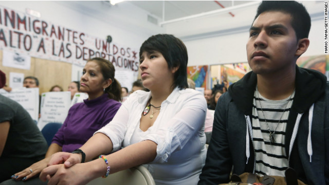 "Oscar Rodriguez, right, sits with Yenny Quispe, at a ""watch party"" for Obama's speech on immigration Tuesday."