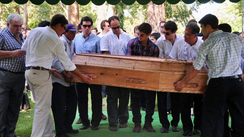 Relatives and friends of Paraguayan student Guido Britez, 21, who died in a fire at the Kiss nightclub in Brazil, carry his coffin during the funeral in  Asuncion on Tuesday, January 29. More than 230 people died and more than 120 were injured early Sunday when a fire tore through the nightclub packed with university students in southern Brazil, police said.