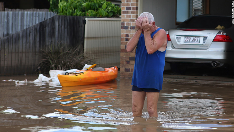 A resident reacts to the damage to his house on Wednesday, January 30, 2013 in Bundaberg, Australia. Parts of southern Queensland experienced record flooding from torrential rains. Floodwaters began receding overnight.