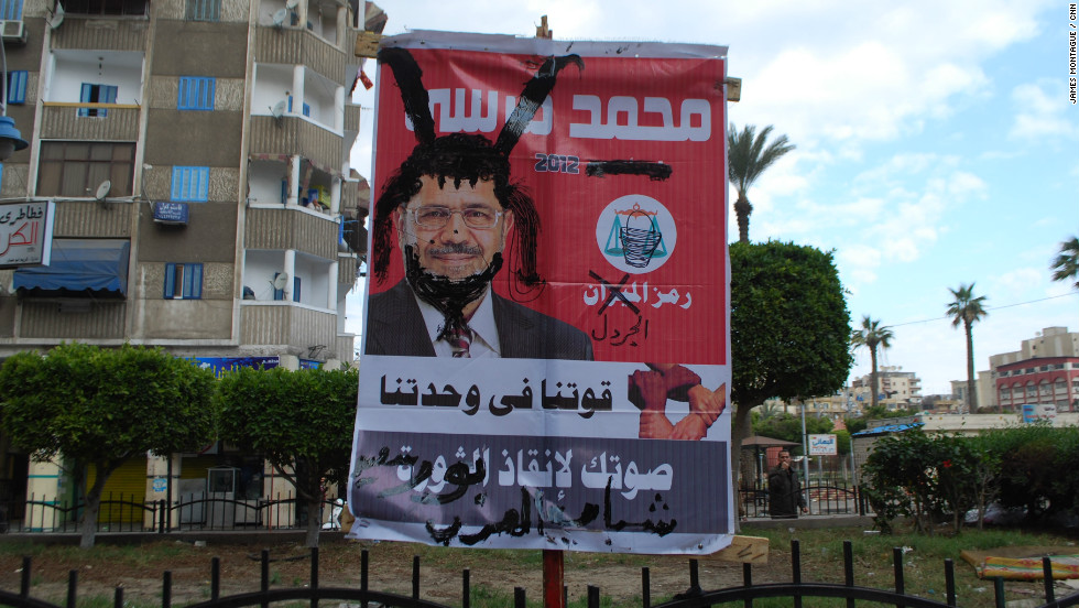 A defaced election campaign poster for President Morsy found nearby.