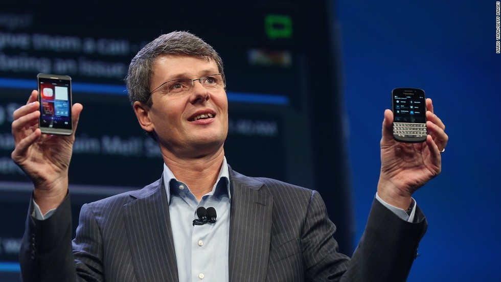 BlackBerry CEO Thorsten Heins displays two new Blackberry 10 smartphones January 30 in New York. The Z10, left, features an all-touch keyboard. The Q10 features a classic BlackBerry tactile keyboard.