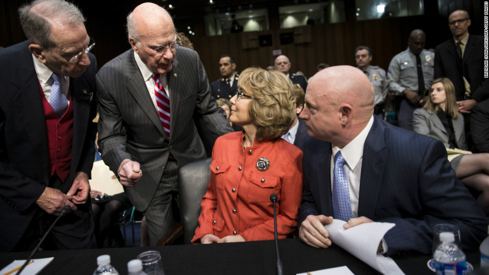 Senate Judiciary Committee member Senator Chuck Grassley (R-IA) and chairman Senator Patrick Leahy (D-VT) talk to Giffords and Kelly before the hearing.
