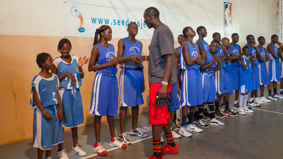 Seven-foot-tall Aziz N'Diaye plays for the University of Washington's basketball team. <br />Born in Senegal, N'Diaye went to the United States thanks to SEEDS, a Senegalese academy that gives teenagers the opportunity to study and play basketball. <br />Last summer, N'Diaye and his Washington teammates visited SEEDS to offer advice to its young students.