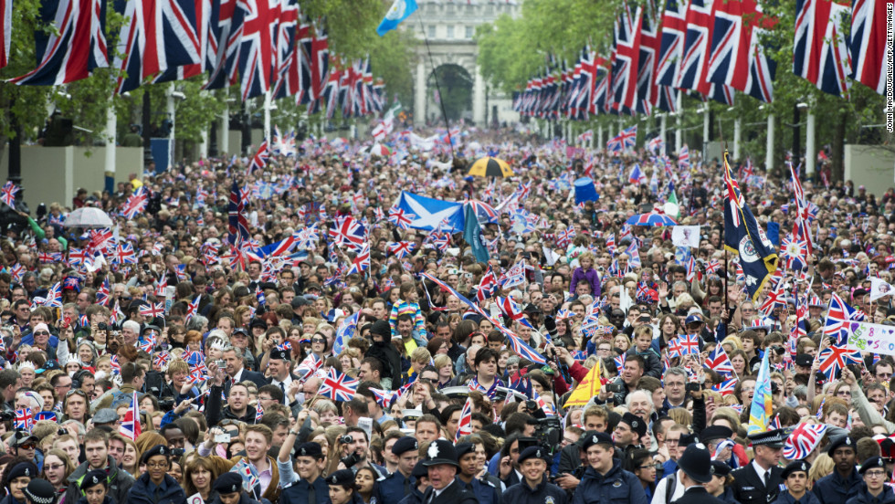 Crowds cheer and wave Union Jacks as they march down the Mall toward Buckingham Palace to celebrate the Queen's Diamond Jubilee in London on June 5, 2012.