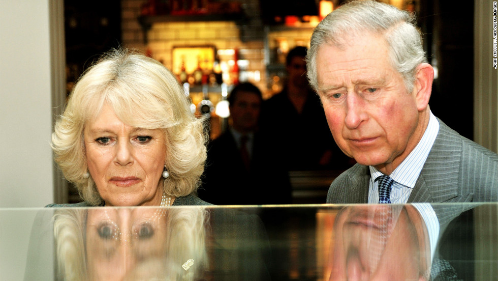 Britain's Prince Charles, Prince of Wales, and his wife Camilla, Duchess of Cornwall, study a model of the refurbished King's Cross train station during an event to mark 150 years of the London Underground. Charles is next in line to the British throne.