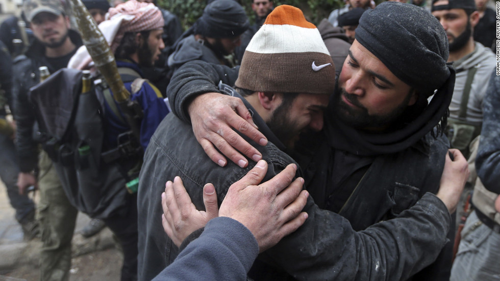A wounded Free Syrian Army fighter cries after hearing that his friend has died.