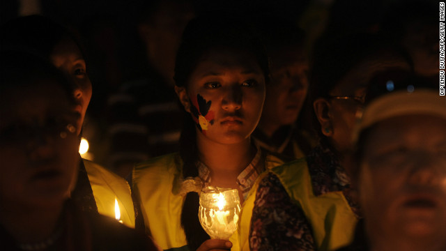 Tibetan monks and members of the Tibetan Youth congress hold candles during a protest in Siliguri on November 28, 2012.