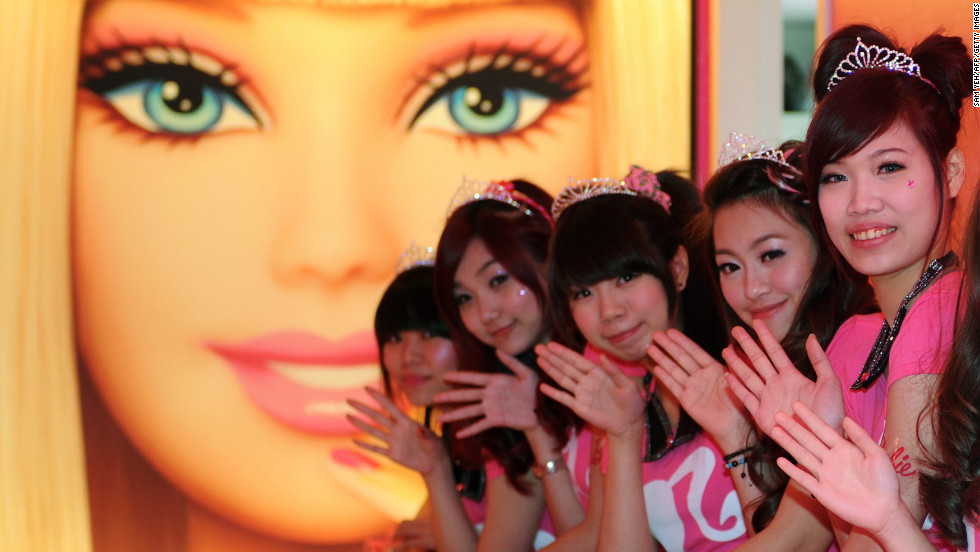 Tiaras and smiles at the opening of Taipei's Barbie Café on Wednesday. This welcome by staff a subtle hint at what lies further ahead.