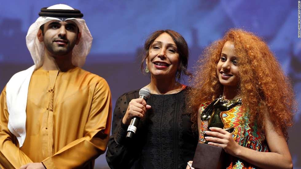"<a href=""http://www.imdb.com/name/nm5152687/"" target=""_blank"">Haifaa Al-Mansour</a>, center, directed Saudi Arabia's first feature film, ""<a href=""http://www.imdb.com/title/tt2258858/"" target=""_blank"">WADJDA</a>"", which won best film at the <a href=""http://www.dubaifilmfest.com/en/"" target=""_blank"">Dubai International Film Festival </a>in 2011."