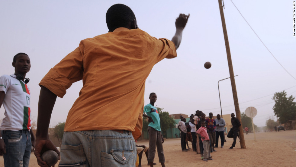 Men play boules, a game that was forbidden under Islamist rule. on January Wednesday, 30, in Gao, Mali.  Gao, once a key Islamist stronghold, was retaken on January 26 by French and Malian troops.