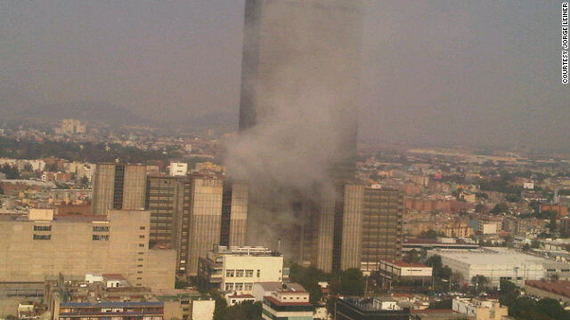 Smoke rises from the Pemex facitily in Mexico City where are large explosion occurred on January 31.