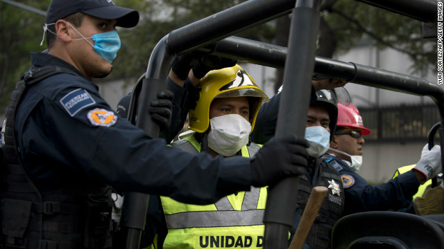 Rescuers are driven inside the premises of the skyscraper that houses the headquarters of state-owned Mexican oil giant Pemex, following a blast inside the building in Mexico City on January 31, 2013. An explosion rocked the skyscraper, leaving up to now 14 dead and 40 injured people, according to official sources. AFP PHOTO/Yuri CORTEZ (Photo credit should read YURI CORTEZ/AFP/Getty Images)