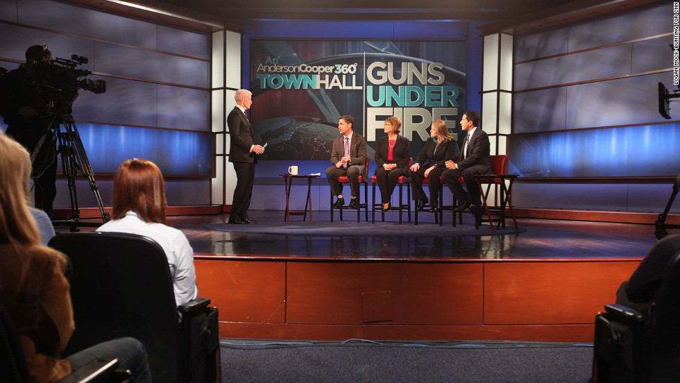 "Anderson Cooper hosts panel members, from left, Dan Gross, president of the Brady Campaign; Sandy Froman, former NRA president; Cheryl Olson, who studies video games and violence; and Sanjay Gupta, chief medical correspondent for CNN, at the ""Guns Under Fire"" town hall event at George Washington University in Washington on Thursday, January 31."