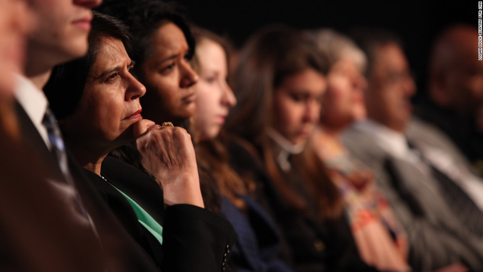 Audience members listen to panelists.