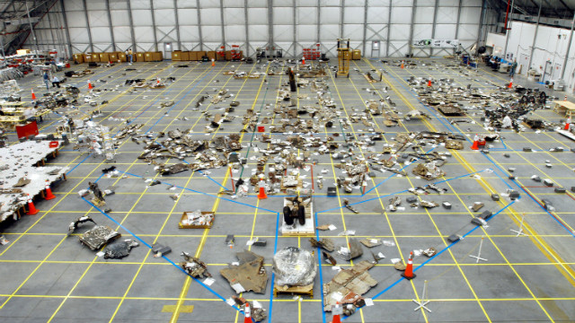 In this handout photo by NASA, the floor of the RLV Hangar is full of pieces of Space Shuttle Columbia debris delivered from the search and recovery efforts in East Texas on May 8, 2003 at the Kennedy Space Center, Florida.