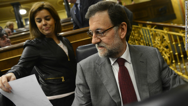 Spanish Prime Miniister Mariano Rajoy (R) attends a Parliament session in Madrid on January 30, 2013. Anger over a long list of corruption scandals implicating bankers, politicians and even members of the royal family is on the rise in recession-hit Spain, putting the spotlight on the failure of the country's democracy to tackle the issue.