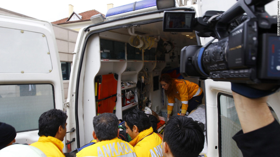 An injured person is put into an ambulance in front of U.S. Embassy.