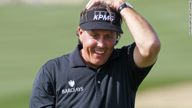 The look on Phil Mickelson's face says it all as his putt for a 59 at the Phoenix Open lips out.