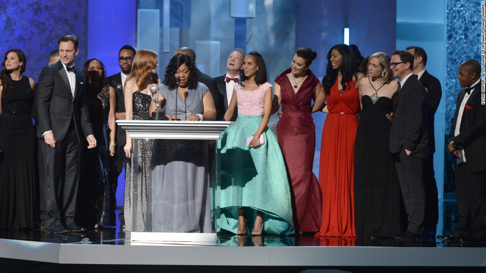 "The cast and crew of ""Scandal"" accepted the award for Drama Series."