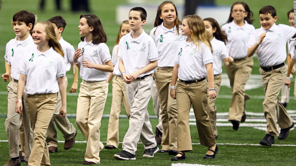"Children in the Sandy Hook Elementary School Chorus walk off the field after singing ""America The Beautiful"" prior to Super Bowl XLVII."