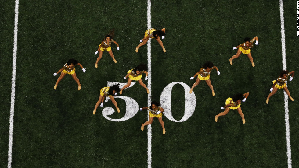 Dancers perform on the field before the start of Super Bowl XLVII.