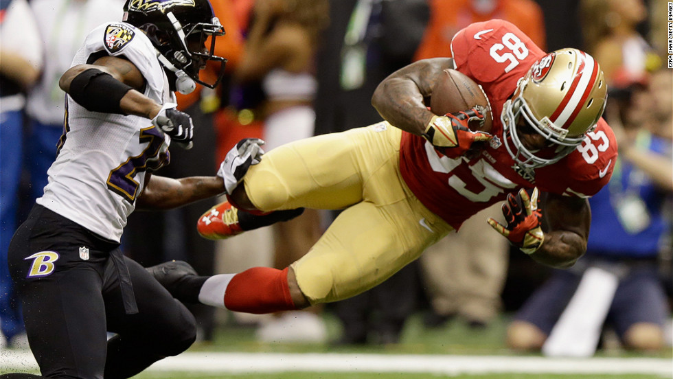 Vernon Davis of the San Francisco 49ers goes airborne after catching a pass against the Baltimore Ravens in the first quarter of Super Bowl XLVII at the Mercedes-Benz Superdome in New Orleans, Louisiana, on Sunday, February 3.