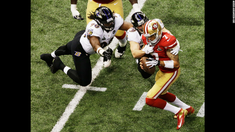 Paul Kruger of the Baltimore Ravens sacks 49ers quarterback Colin Kaepernick.