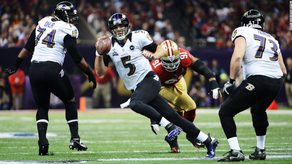 Ravens quarterback Joe Flacco scrambles with the ball against 49ers defensive end Ray McDonald.