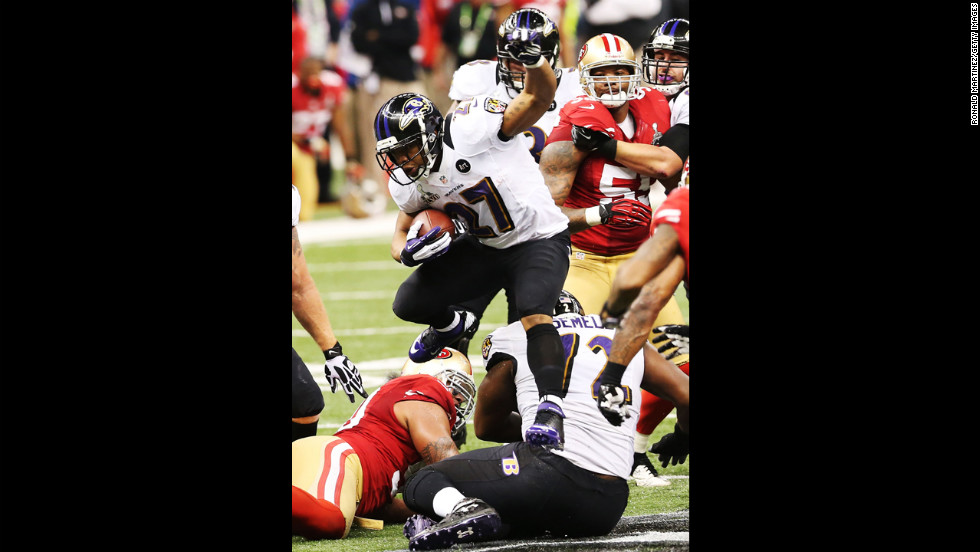Ray Rice of the Baltimore Ravens runs the ball against the 49ers.