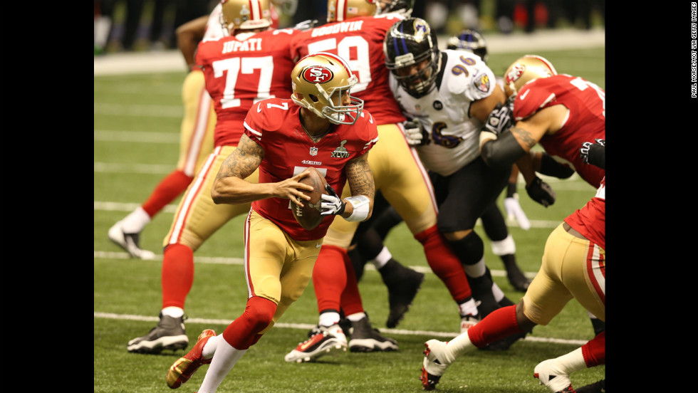 Quarterback Colin Kaepernick of the 49ers rolls out of the pocket and looks to pass during the second quarter.