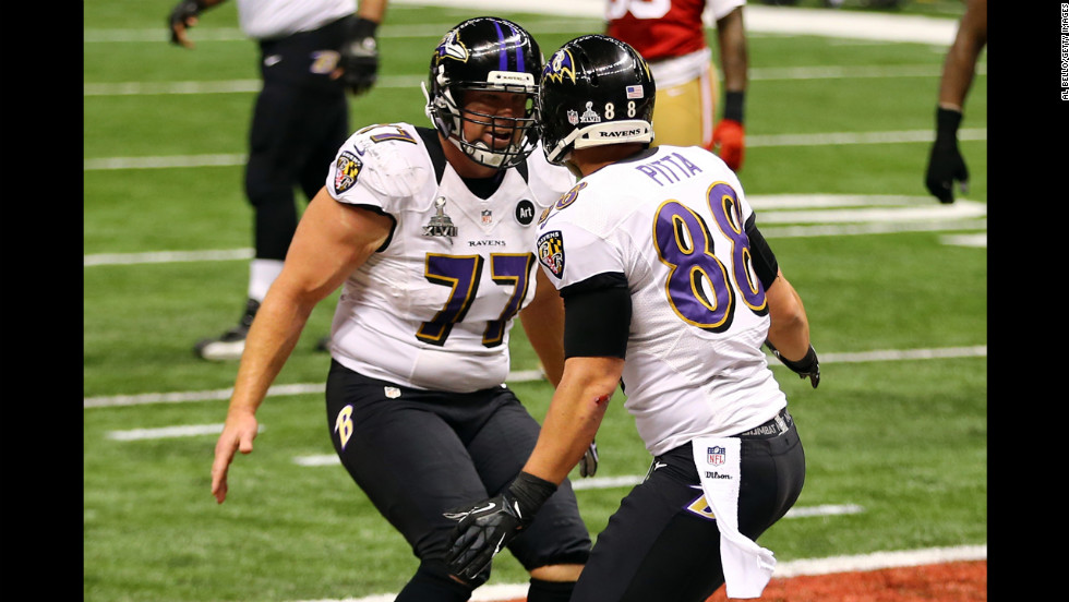 Dennis Pitta of the Baltimore Ravens, right, celebrates with teammate Matt Birk after catching a touchdown pass in the second quarter.